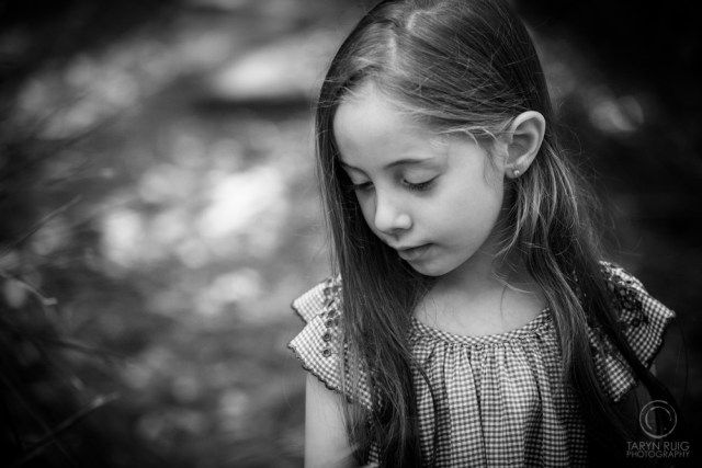 Young girl looking down parramatta sydney family portrait photography taryn ruig photography