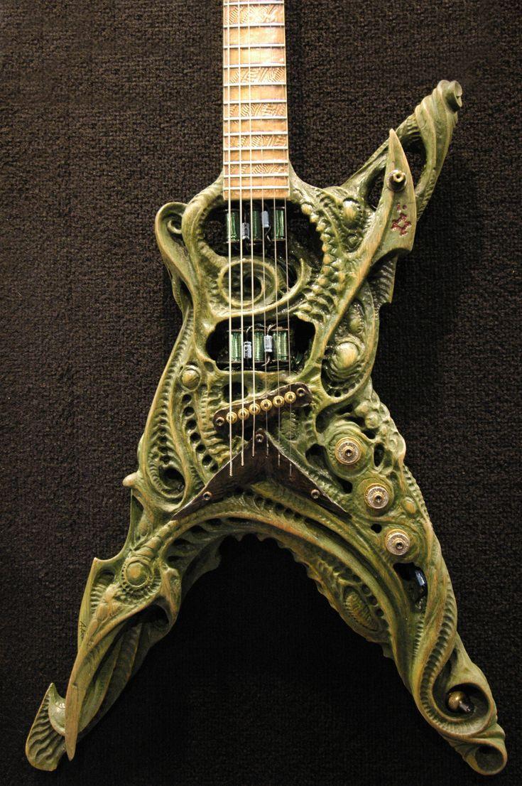 HR Giger / Alien style guitar. Incredible artwork. www.guitarandmusi...