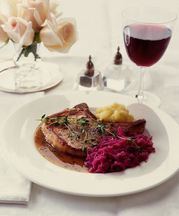 An economical cut of pork is paired with cabbage in this German meal that has a lot less salt than Eisbein mit Sauerkraut, on which it is based.