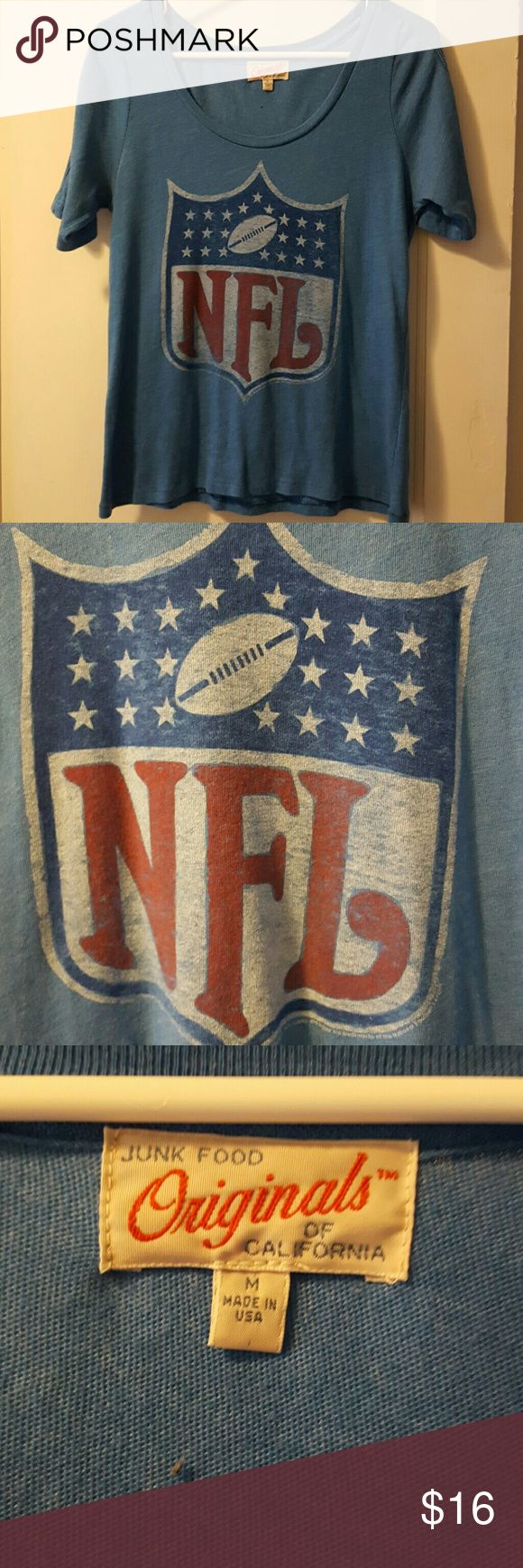 Ladies NFL t-shirt Just in time for game day! Short-sleeve, scoop neck, cute ladies NFL t-shirt. Light Blue. 50 percent cotton, 50 percent polyester. Never been worn! Junk Food Tops Tees - Short Sleeve
