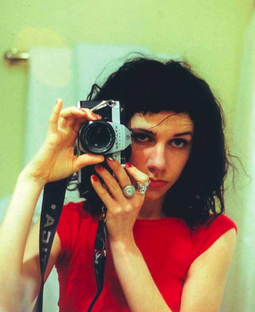 Faux selfie with analog camera. Could be killer and have a certain raw feel to it. Red clothes to pop would be pretty cool. Def interesting mix for your portfolio