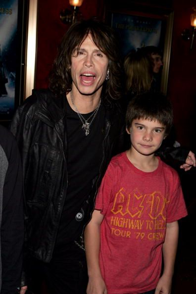 NEW YORK - NOVEMBER 8: Singer Steven Tyler and his son Taj Tyler arrive for the premiere of ' Polar Express' at the Ziegfeld Theater November 8, 2004 in New York City.