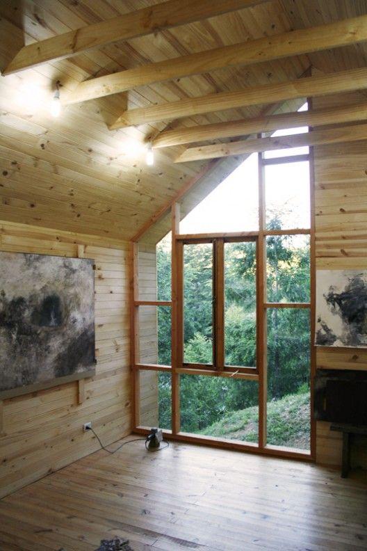 Direct glazed wood storefront window wall, interior/exterior wood siding