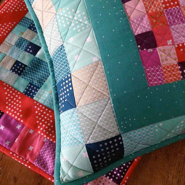 Pretty patchwork pillow by A Modern Twist author Natalie Barnes, made with Cotton + Steel Basics. Learn how to make it at the Sew Mama Sew blog!
