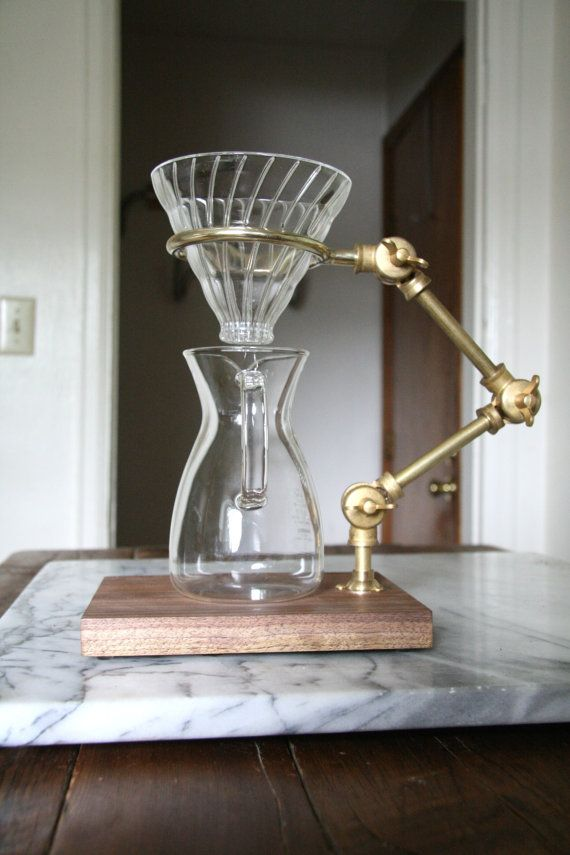 Crafted from brass, The Curator utilizes the Hario V60 glass pour over (included) resting on the ring that adjusts to the height of your mug or