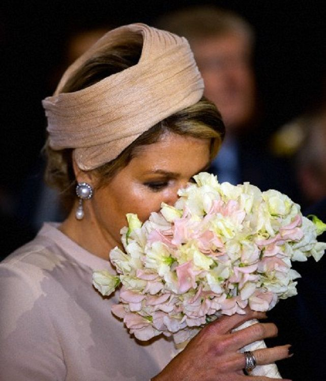 Dutch Queen Maxima smelling flowers as she visits the Achterhoek region in the province Gelderland in the Netherlands, 06.05.2014.