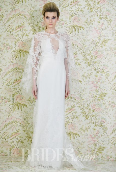 Brides.com: . Trend: Capes. Style N11003, backless lace trumpet wedding dress with a deep v-neckline and attached jewel-neck cape, Angel Sanchez