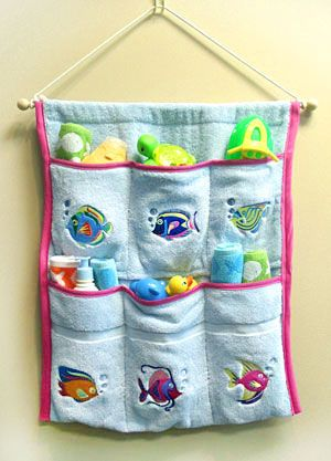 Splish-splash, we're stitching for the bath! Constructed from a terrycloth towel, this colorful caddy has six convenient pockets, perfect for organizing all your bath necessities -- toiletries, washcloths, tub toys for the little ones, and much more.