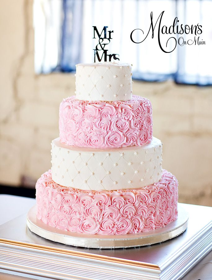 Soft pink and ivory...... - My bride wanted to alternate tiers of ivory and pale pink.  She chose a quilted pattern on the top and third tier, and a pale pink rosettes on the second and bottom tier.  I loved their Mr and Mrs topper, and the stand the groom made to match!  Sweet and simple!  I drug my husband along to take the pics for me as well!