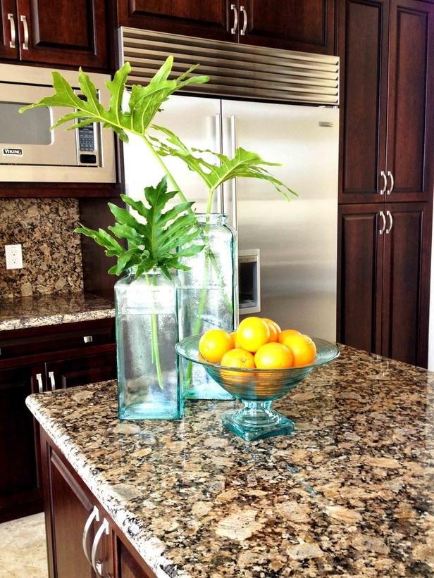 Dark cabinets, light floors and counters/backsplash that contains both.- Kitchen Countertops: Colors and Materials on HGTV