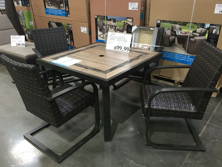 AGIO INTERNATIONAL 5 piece dining set with motion chairs at COSTCO $899