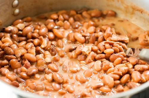 Pinto beans were inexpensive and easy (for Mom at least) to make....now my husband cooks them for us because mine just never seem to turn out the way I want them to taste.  Mom would either cook hers with a ham hock or the thick slab of bacon you had to slice yourself.  We usually had it with cornbread and fried potatoes or just the cornbread.