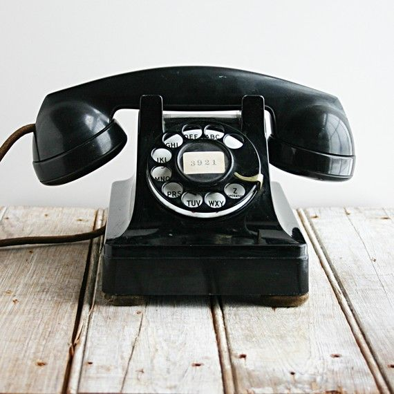 Vintage Telephone, black on white floorboards Repinned by www.silver-and-grey.com