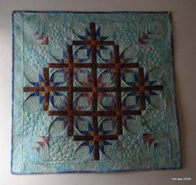 The batik Mexican Star quilt is finished and up on the wall!