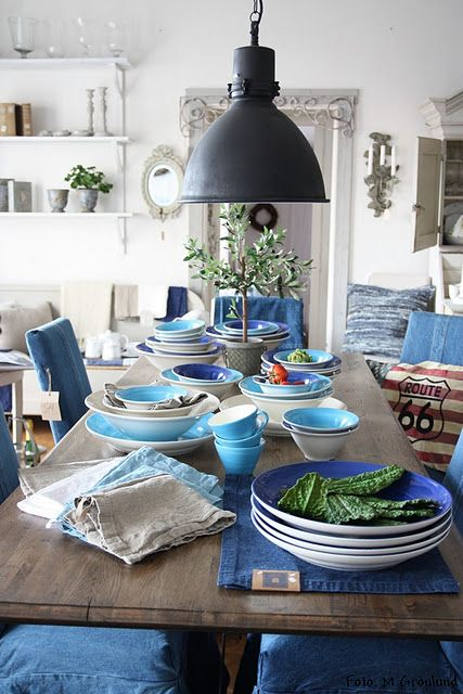 denim placemats... would match the accent wall and be easy to clean.