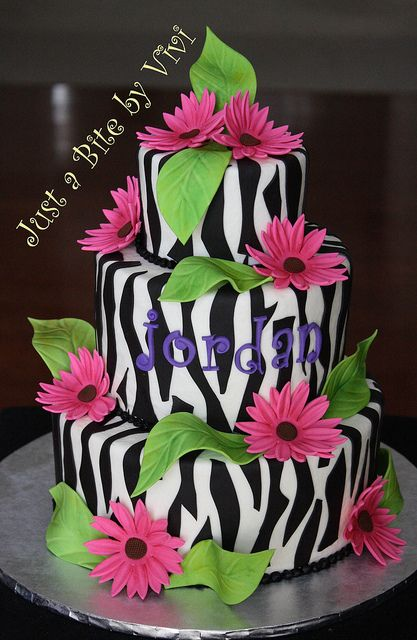 ZEBRA CAKE  My last cake of 2010..!  The lady loved my birthday cake (the leopard print one), but to make it a little different, she ordered it with a Zebra print instead. I loved it...! She also asked me to leave the white buttercream in the background (less fondant), so just the balck stripes, leaves and flowers are fondant this time. White cake with chocolate filling