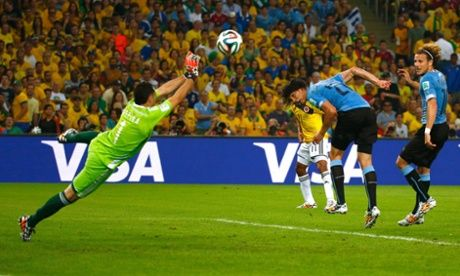 David Ospina parries a header from Cristian Rodriguez but Uruguay's Edinson Cavani was in an offside position.