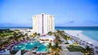Cancun Vacations - Krystal Grand Punta Cancun with OPTIONAL All-Inclusive - Located in Punta Cancun, the 4-star Krystal Grand Punta Cancun enjoys a unique beachfront location of the tip of the Cancun Peninsula that offers stunning views and an extensive beautiful white sand beach.