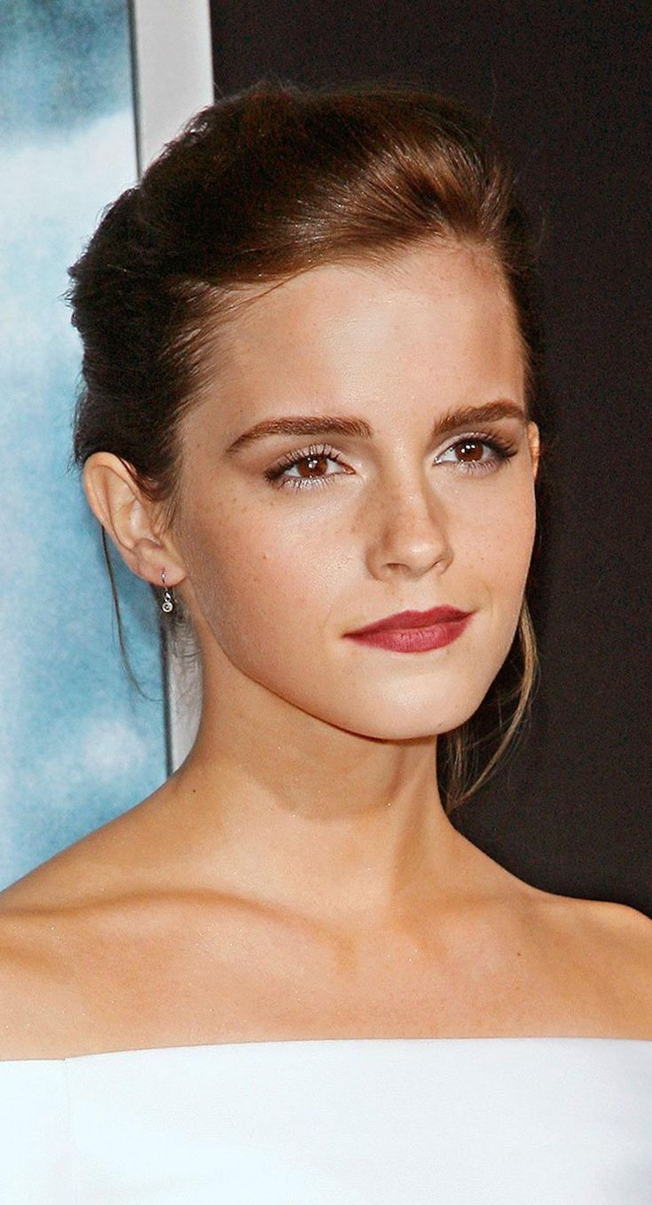 Emma Watson's full brows, red lip, summer glow and dash of freckles