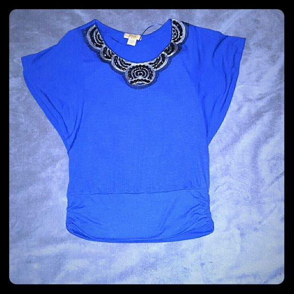 Royal blue batwing top with beading around neck Beautiful royal blue blouse with black beading around neck. Only worn once. Has rutched fitted bottom. Excellent condition. Size petite large Valerie Stevens Tops Blouses