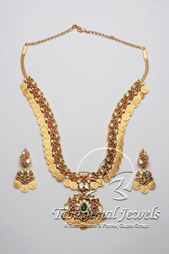 Indian Jewellery and Clothing: Unique design of antique kasulaperu studded with rubies,cz stones and emerald stone in the middleof the pendant