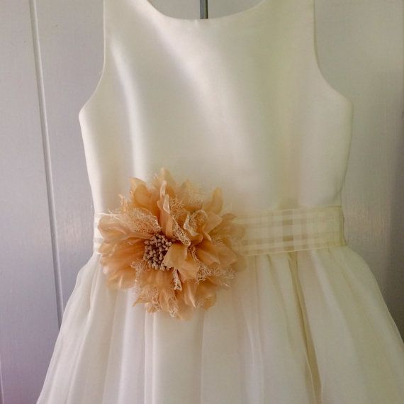 First Communion, Flower girl, Miniature bride, Princess sash, Birthday The sash shown is ivory chiffon ribbon and the silk flower is dark blush light peach color. A lovely look for your flower girl or First Communion attire. It is easily worked into any wedding style, First Communion and is comfortable for any little girl to wear. :: The Details • ribbon width 2 inches • flower size 5 inches • sash length 36-45 inches • available in any color combination and size. •Flowers can be customized…