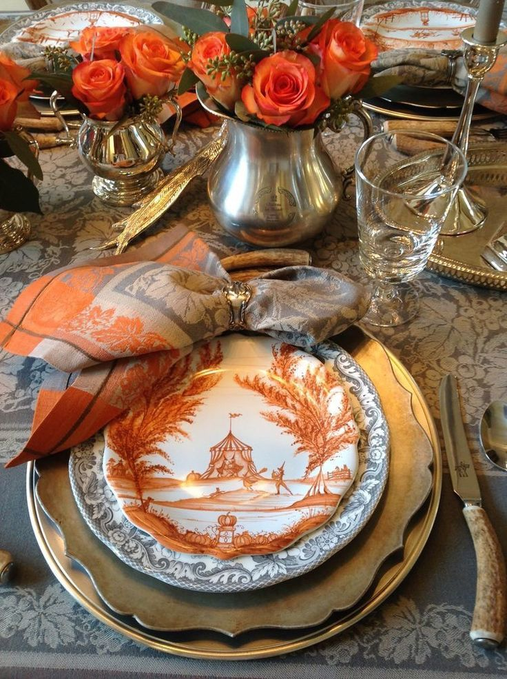 orange scenic plate, scalloped charger, just and grey linen napkins. A rustic, elegant tablescape. Autumn tablescape