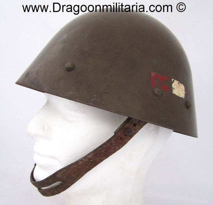 WW2 Czech M/34 helmet.  At left side of helmet with painted infantry regiment 27 unit marking, red-white insignia.  Original 1930´s green-brown paint.  Shell inside marked S-D-H (Sandrik Doln Hamre) 38. Finland bought 50 000 pieces of  this helmet type in 1940.