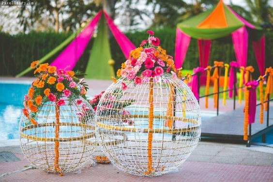 Stunning mehendi decor inspiration | DIY decor ideas | Fairy light balls | Poolside mehendi decor ideas | Colorful drapes | Flower decor | Indian wedding decorations | Picture Credits: Pixel Story | Every Indian bride's Fav. Wedding E-magazine to read. Here for any marriage advice you need | www.wittyvows.com shares things no one tells brides, covers real weddings, ideas, inspirations, design trends and the right vendors, candid photographers etc