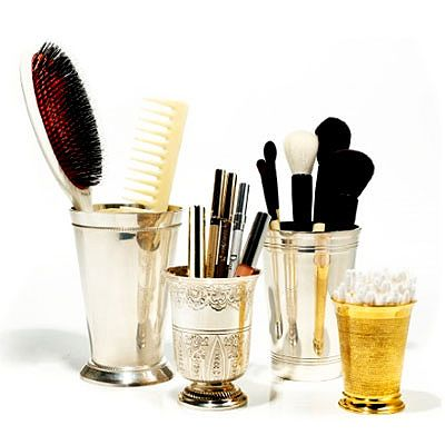 This is a really stylish way to hold makeup and brushes! (Julep cups)