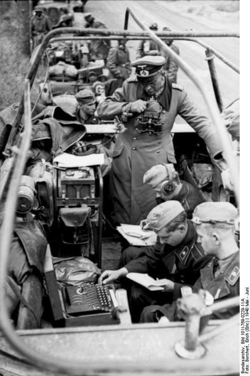 "Heinz Guderian in armoured Sd.Kfz 251/3, front radio operator with the encryption device ""Enigma"""