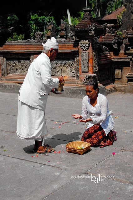Receiving holy water. Bali, Indonesia