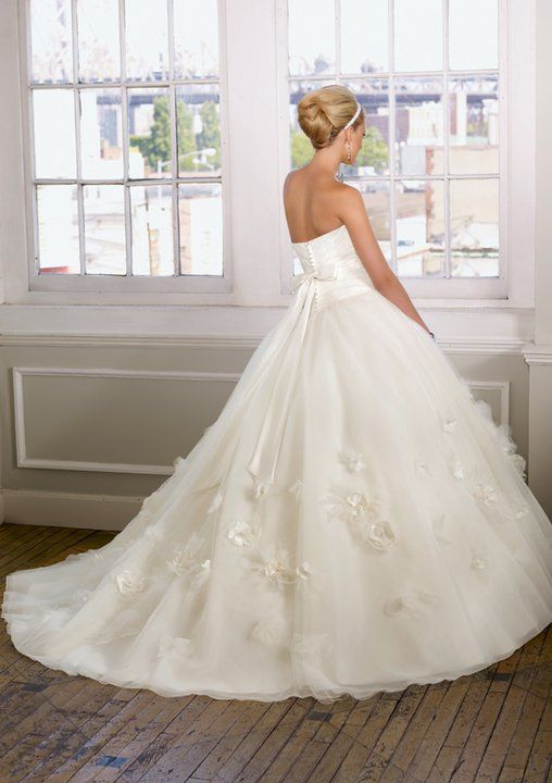 Wedding dress - I like the corset top & the details on the skirt