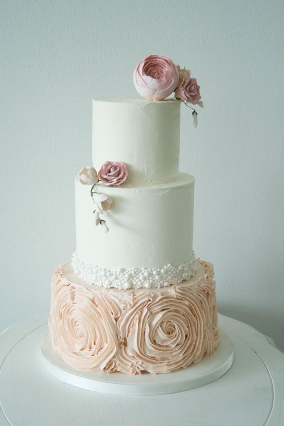 Featured Cake: The Cocoa Cakery; Three tier blush wedding cake idea.