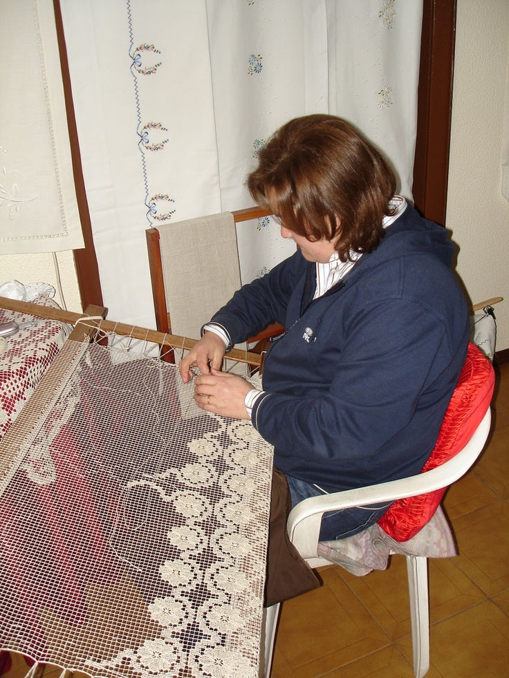 Lacemaker in Portugal SHe's working with Filet lace. When I get profficient this is the kind I want to make. I'd love to make my own wedding veil.