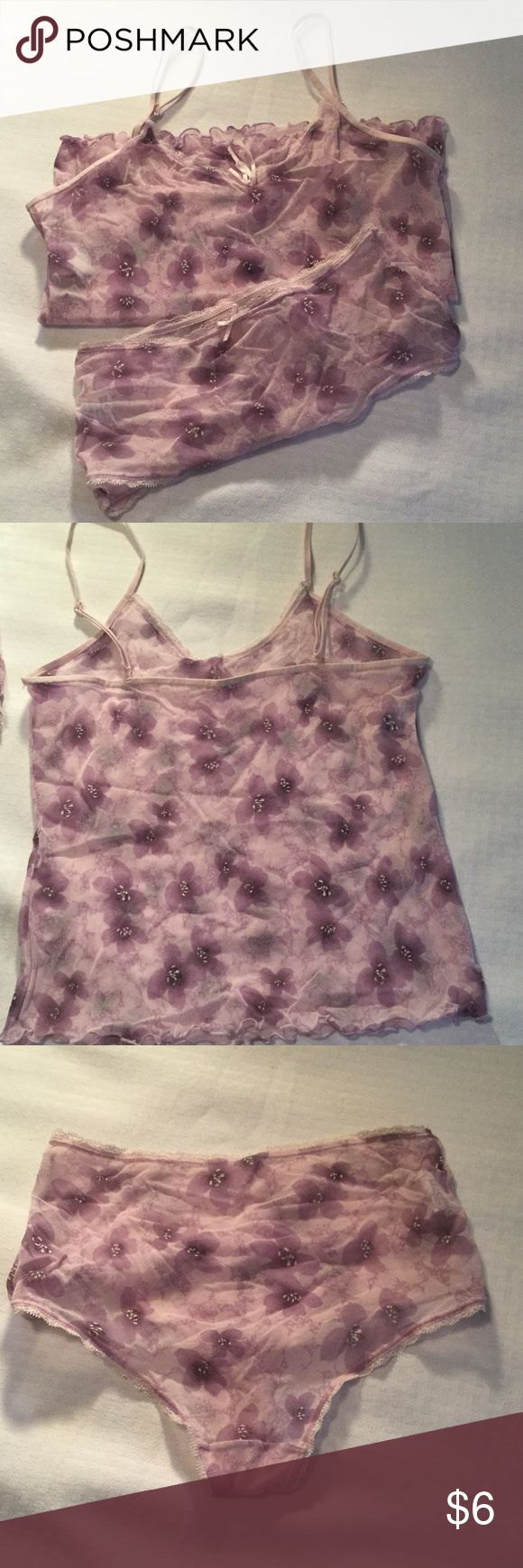 Cute and sexy flowered pj set 2 shades of purple. Mostly see though. Tank has adjustable shoulder straps, no lining. Bottoms have cotton lining like underwear. Bottoms are a large but fit like a medium. Top is medium. Only worn a few times and hand washed. warner Intimates & Sleepwear Pajamas