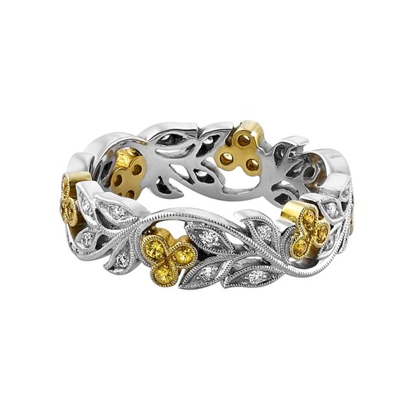 A classic Ungar & Ungar example of the filigree style design. Set with yellow sapphire and diamond. The yellow sapphires are set in 18-carat yellow gold. www.kellerwood.com