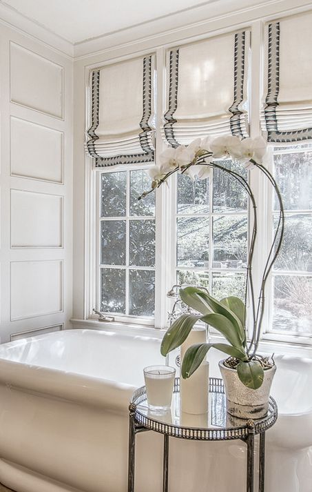 Elegant master bath with three roman shades