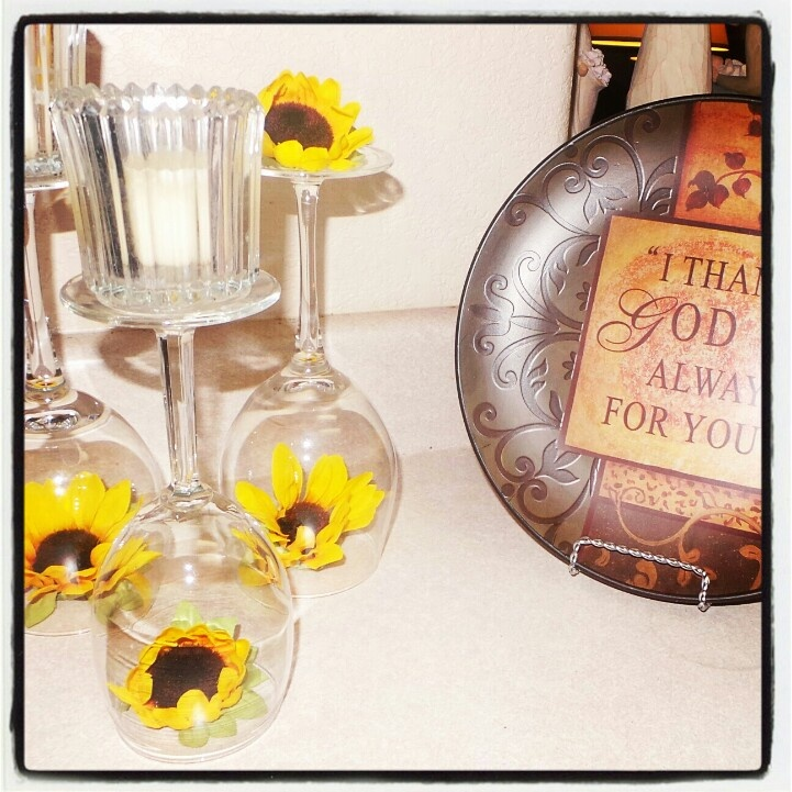 Sunflower themed kitchen  Hobby lobby sunflowers i got 50% off..some unused wine glasses and some old candles...simply beautiful :) ~♡Brezi