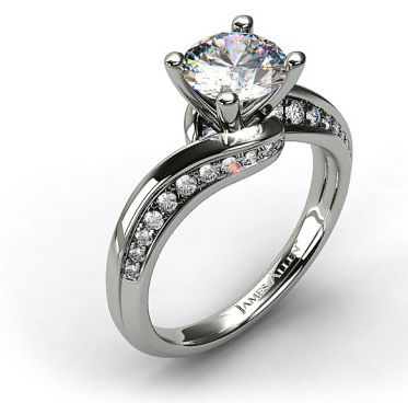 inspired by antique designs this modern style engagement ring features a swirling pave shank