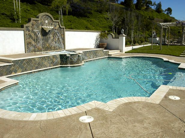 Tuscan style outdoor pool and spa makes perfect respite