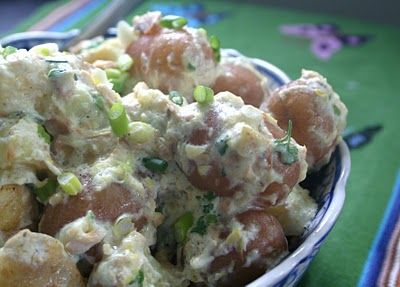 Earls Warm potato salad  2 cups mayo 1 cup sour cream 3 cloves garlic crushed 1 tsp real lemon juice 1/4 cup grated parmesan cheese 1/4 cup melted butter 1/4 cup fresh dill 1 tsp salt Real bacon bits 5 lbs Small potatoes  Boil potatoes until tender. In a bowl mix mayo, sour cream, garlic, lemon, cheese, butter,  and fresh dill. Whisk until well mixed.  In a large bowl, toss bacon, and hot potatoes. Pour the dressing mix over all and toss lightly. Serve warm.