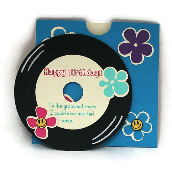 This Personalized 60s Photo Album Cover w/Record-Style Greeting Card is Outta Sight ! Your picture is customized onto a vintage-inspired record album covered in flower power embellishment. See your personal message written on a record which is tucked inside the album sleeve. (Envelope Included) This is designed to be displayed! With the card/album measuring 6x6 it can either stand on a mantel or be framed! ----Beautiful wrapping is available for both standard & framed options! Just Add…