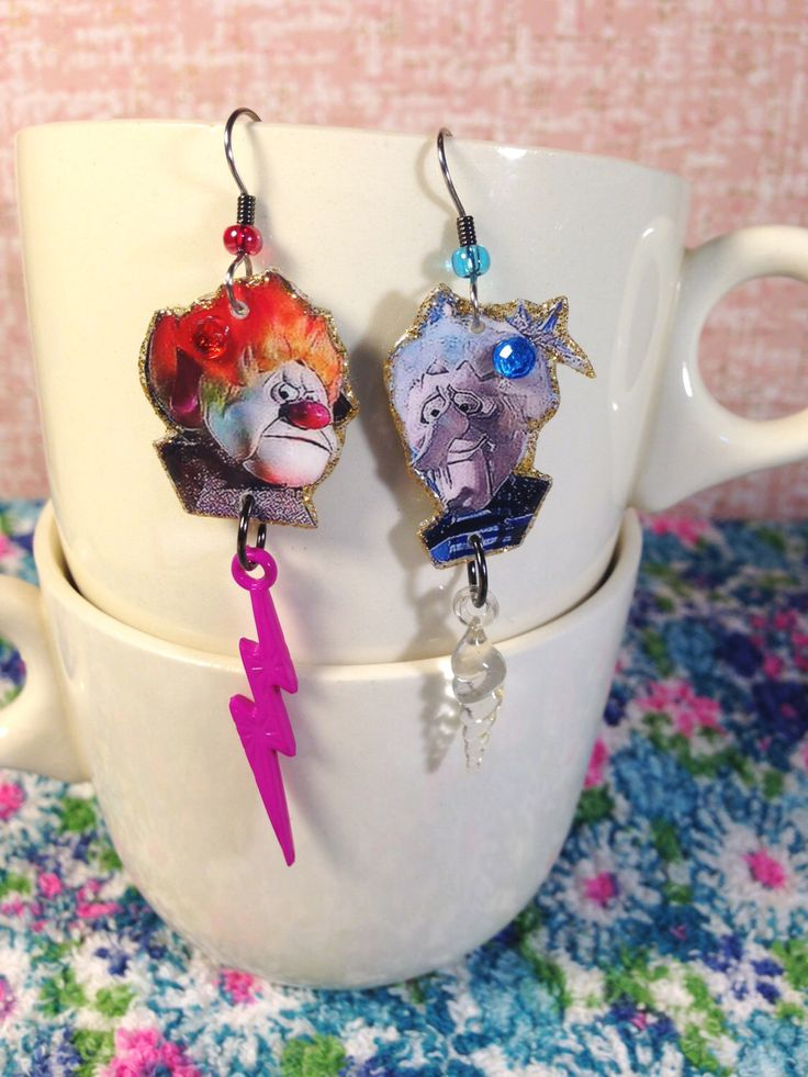 Heat Miser and Snow Miser Earrings  The Year Without a Santa Claus by ilovemyauntdebbie on Etsy https://www.etsy.com/listing/34987254/heat-miser-and-snow-miser-earrings-the