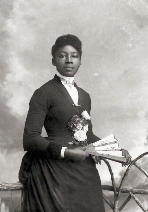 A portrait of an African American woman in Victorian fashion. Taken, however, in the 1880's (dress may be from a few decades earlier)