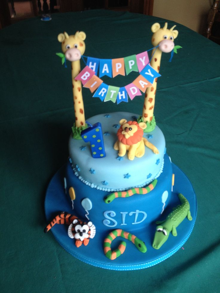 Jungle animal cake with birthday bunting for a boy's first birthday