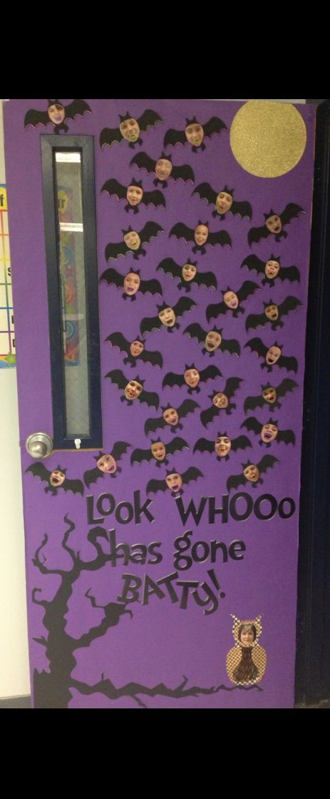 2013 Halloween door. The kids all had fangs for the pictures, the owl was made out of several different fall cardstock and the teacher's picture. The girl bats had purple glitter around the faces and base of wings and the boys all had green glitter around the face and base of wings. Moon was made out of glitter paper.