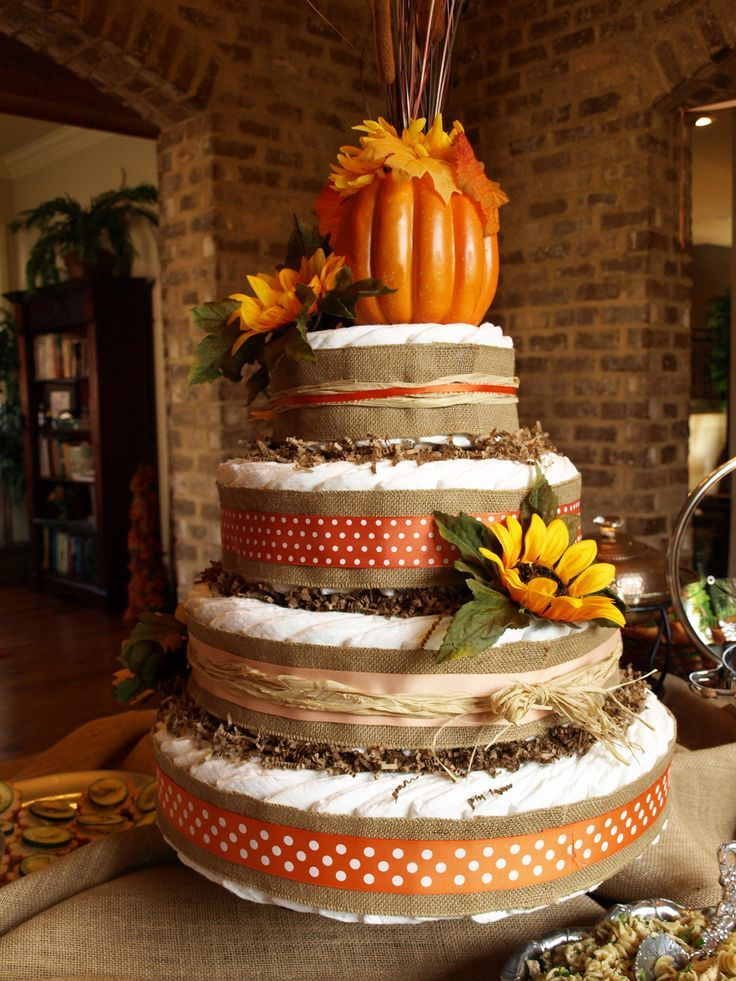 Festive October Baby Shower. Adorable pumpkin and sunflower-adorned diaper cake!