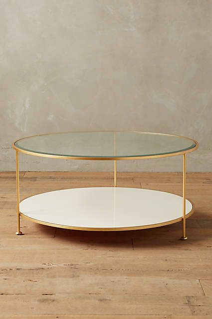 The coffee table is also nice, not sure if you like glass top. Lacquered Round Coffee Table - anthropologie.com