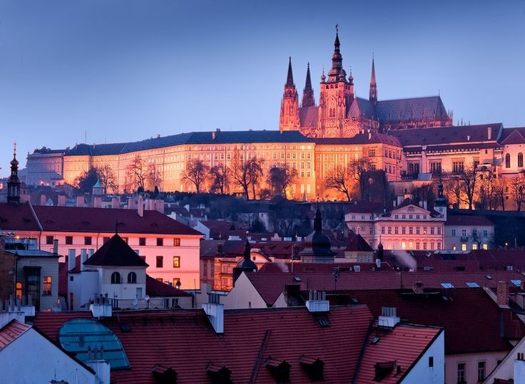 https://flic.kr/p/9qFjjG | The Czech Republic - Prague: Magic Castle | A magical looking castle stands watch over the Lesser Old Town in Prague.  The Prague Castle is a castle in Prague where the Kings of Bohemia, Holy Roman Emperors and presidents of Czechoslovakia and the Czech Republic have had their offices. The Prague Castle is the largest coherent castle complex in the world with an area of almost 70000 m².  Jon & Tina Reid  |  Travel Portfolio   |  Photography Blog   |  Travel Fli...